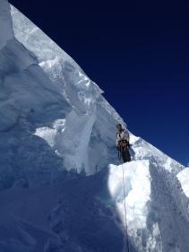 Crossing below a serac. Mount Baker