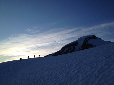 A team climbing the Coleman Glacier on Mount Baker